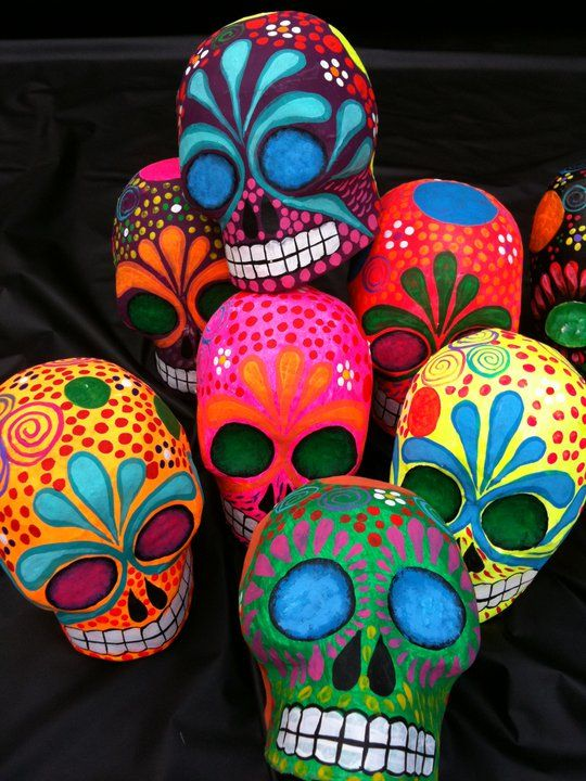 Papier Mache skulls! This is a great alternative to flat paper designs.... maybe even do them in clay with low fire bright underglazes!
