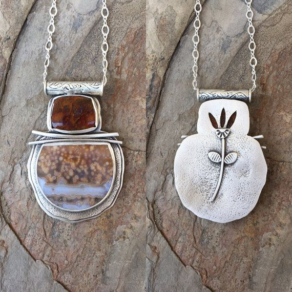 This is a fairly substantial necklace. The Ocean Jasper cabochon measures 32 mm x 28 mm and the other stone is 20 mm x 15 mm. The pendant measures 2.25 by 1.5 in total, including the Thai Silver bale. It hangs from an 18 sterling silver chain. I design and make all of my jewelry in my home studio in Texas. All I make goes to charity - see coldfeetstudio.com and click the Giving Back tag All my jewelry is hand formed using one or more of the following: Fine silver, Sterling silver, Thai ...