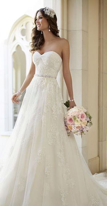 Vintage inspired tulle a-line wedding dress with diamante-embellished lace detailing.