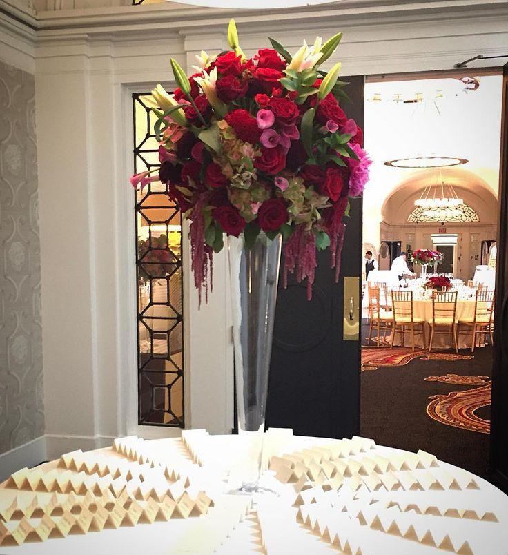 A dramatic 5 foot arrangement to welcome wedding guests. #floral #florals #flowers #florist #junewedding #roses #peonies #calla #lillies #dahlias #coxcomb #weddingflowers