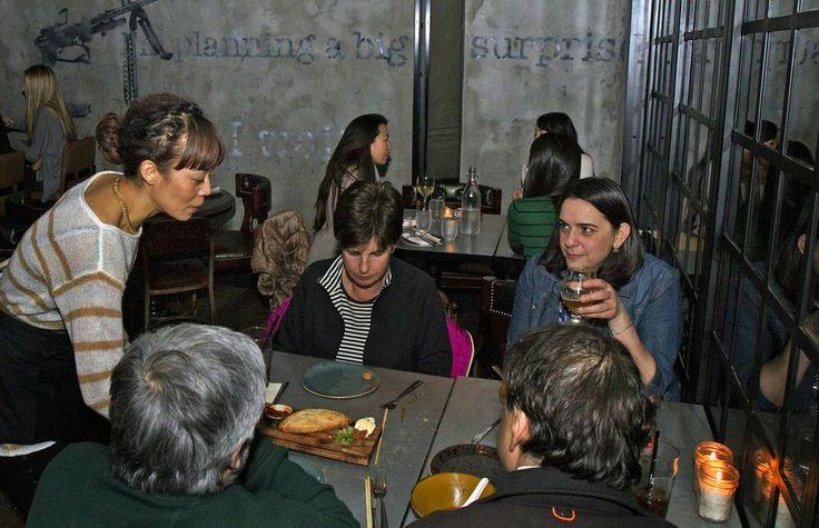 Little Sister in Manhattan Beach ( Cheryl A. Guerrero / Los Angeles Times ) Waitress Jessica Kinoshita, left, serves a table at Little Sis...