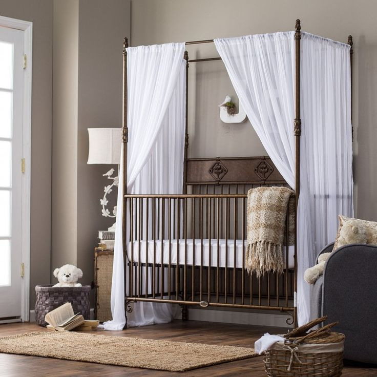 Furniture. Nursery Room Indigo Wrought Iron Baby Crib with White Silk Netting. Classic Style Bedroom with Wrought Iron Bed Furniture Set
