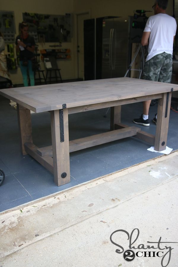 Build this simple DIY Industrial Farmhouse Table with only framing materials and five tools! How-to video and free plans at www.shanty-2-chic.com.