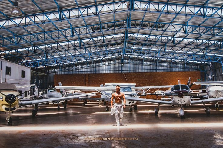Fitness Photo in Hanger with aircraft