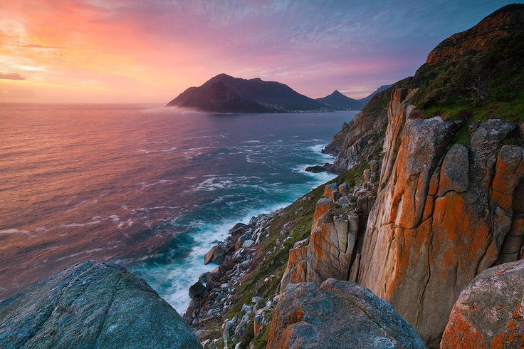 Landscape photograph of Sunset over Hout Bay and the Atlantic ocean as seen from chapmans peak drive  Photo: Hougaard Malan