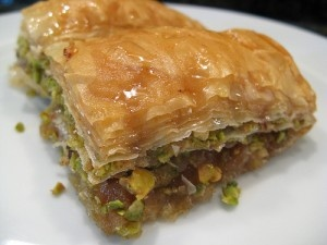 Baklava- people think it's greek/turkish...but it stems from the arabic words baql (nuts) + halawa (sweets).Best when made with honey not sugar-water I think.