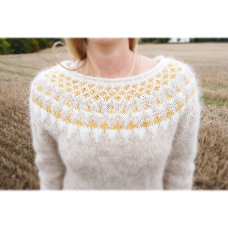 Icelandic sweater Lopapeysa made in Plötulopi held double. Colours: 1038 Ivory beige, 1424 golden yellow heather, 0001 white. Yoke: modified Istex Lopi 131.
