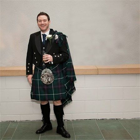Allan wore a traditional Scottish outfit for his wedding day. He bought his kilt, a MacDonald Modern Hunting style, from the Celtic Craft shop in Edinburgh, but hired the rest of the groomswear from Slaters. The groomsmen wore Black Watch tartan kilts, and they all wore five button waist coats, Prince Charlie jackets and white shirts with black socks.
