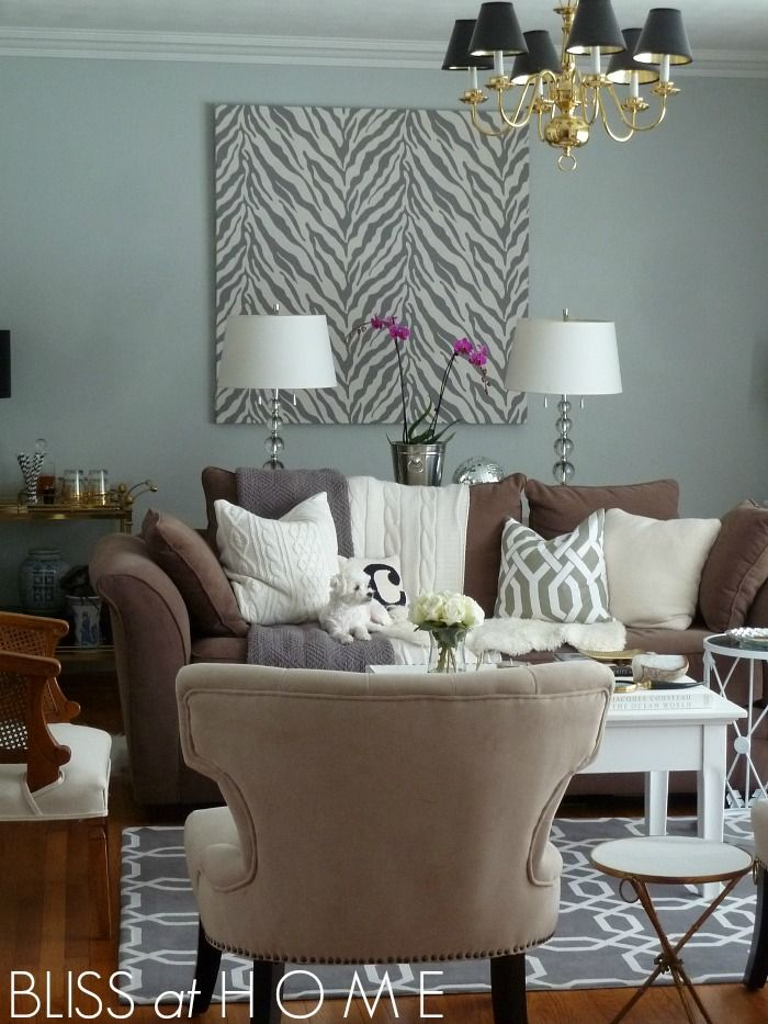 Living Room Refresh for spring with paint. Color is Valspar Signature Sleek Gray.