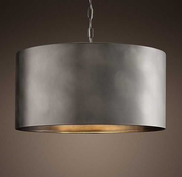 RH's Antiqued Metal Drum Pendant:Send focused light upward and downward via our metal-shaded pendant inspired by an industrial pipe section – a seamless wrap of steel with an aged, burnished finish.