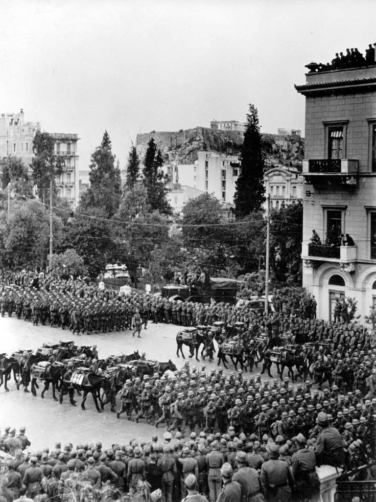 German troops parade in Athens, Greece in May 1941. This was the victory parade of the German occupiers. The building in the right foreground is the Grand Bretagne hotel -- still in operation today. The location is Constitution square. The parliament building and the Tomb of the Unknown Soldier are across the street on the left.