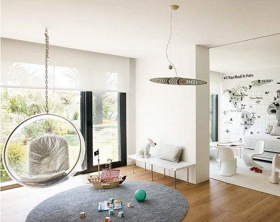 This modern kids room is full of open space and fun furniture.