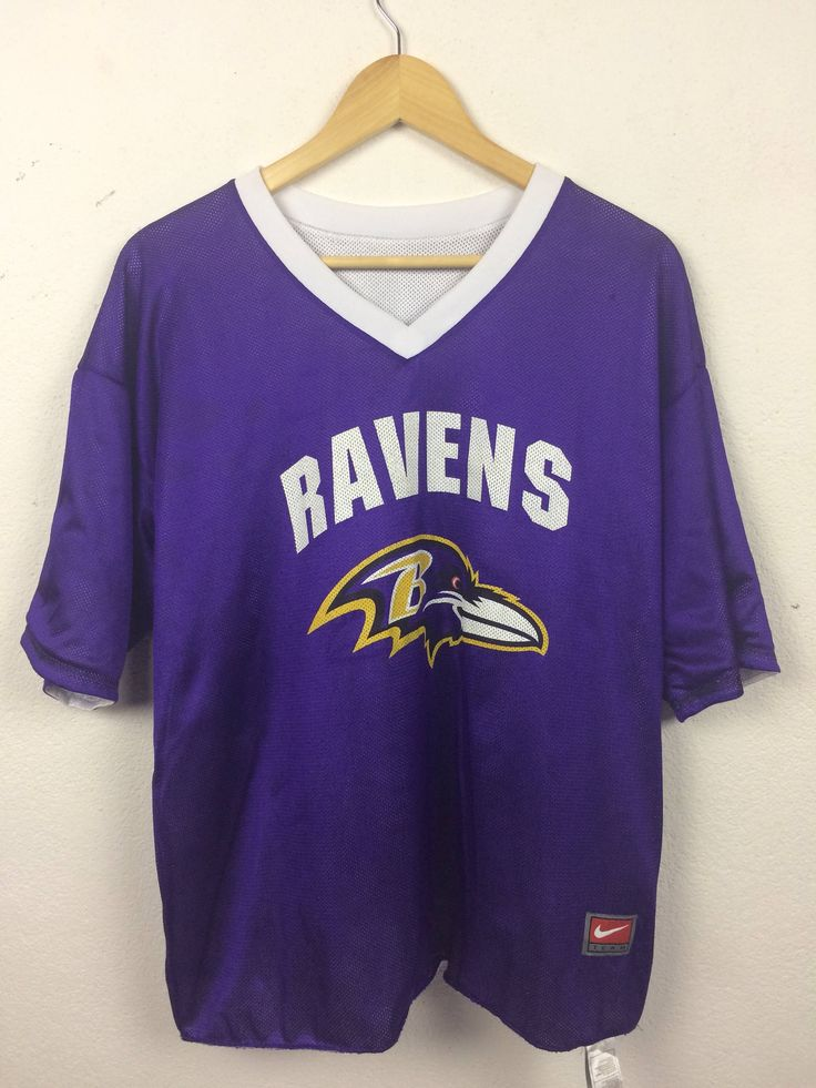 A personal favourite from my Etsy shop https://www.etsy.com/listing/520529430/vintage-90s-nike-ravens-sport-nfl
