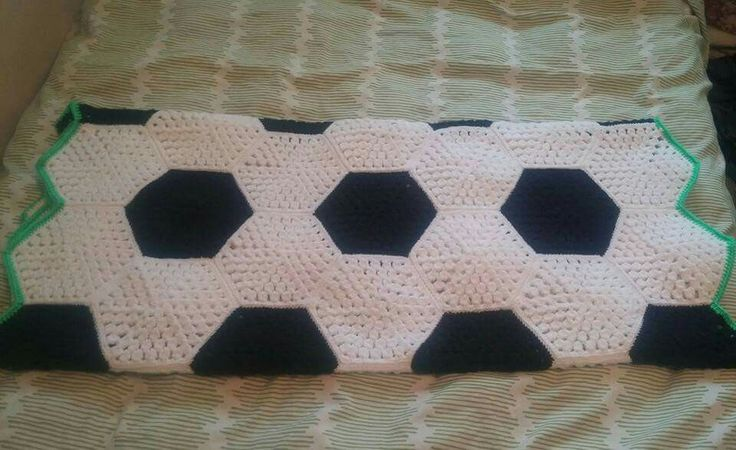 Soccer afghan made of hexagons and edged in green