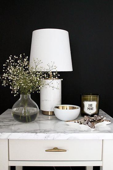 domino shares white marble decorating ideas. How to decorate with brass and marble.