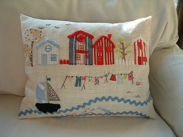 embroidered/applique cushion. this is absolutely gorgeous.
