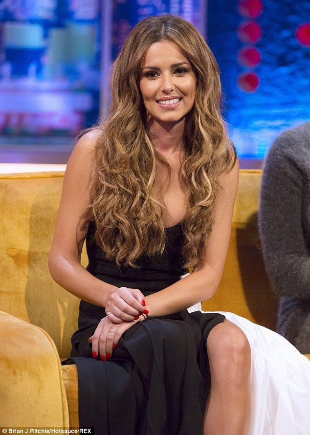 Beaming: Cheryl, looking stunning in a floor-skimming dress, shot wide smiles when her new husband Jean-Bernand was brought up in conversation with host Jonathan