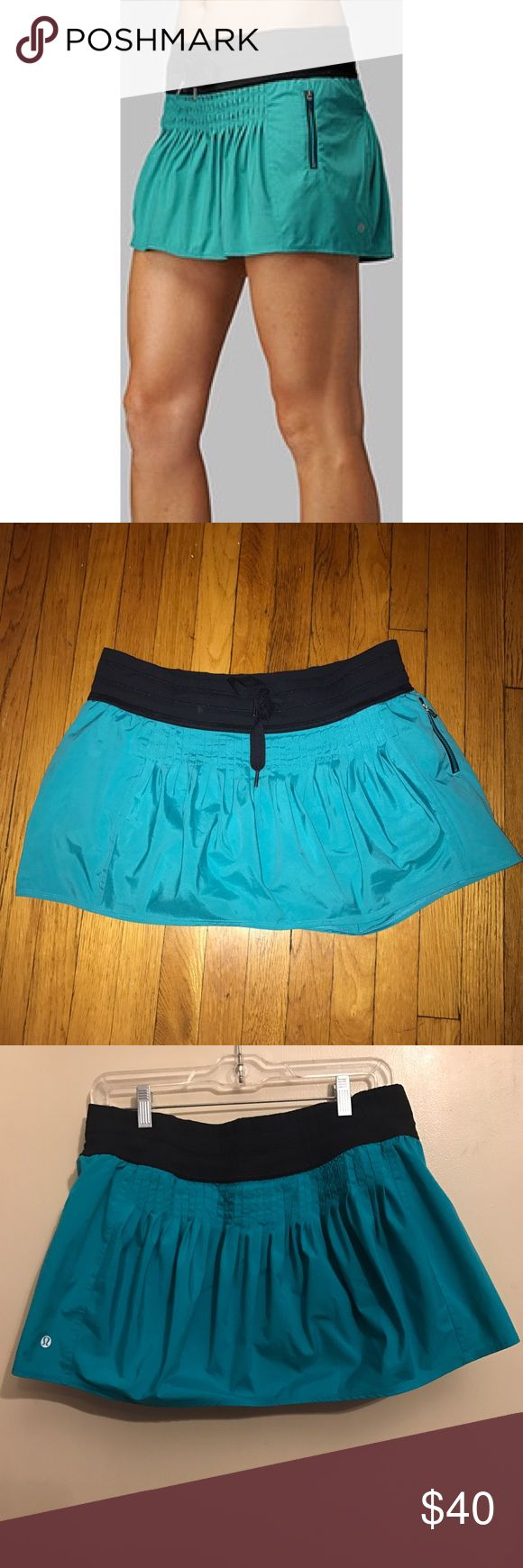 Rare Lululemon Teal Revitalize Skirt Size 10 Hard to find Revitalize skirt from Lululemon. Beautiful teal color is true to the Lululemon stock cover photo. Black shorts with glitter gel grips under the adorable pleated skirt. Black drawstring waist band and zipper pocket detail. Skirt has a lot small brown mark as shown in the photo that is not very noticeable. Otherwise it's in great condition. Size 10. Comes from a smoke and pet free home. lululemon athletica Skirts Mini