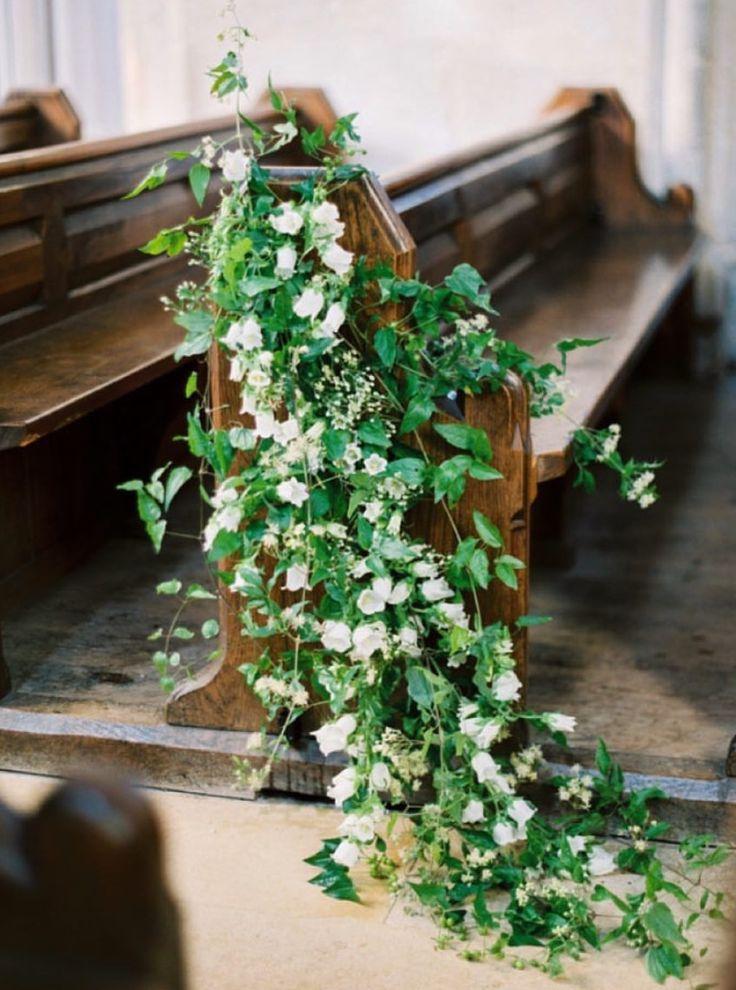 Stunning wedding pew decorations!