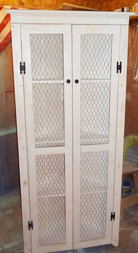 This corner shelf cabinet measures 72 tall, with each side at 22 deep. Doors have chicken wire and a middle wood brace for stability. Would be great