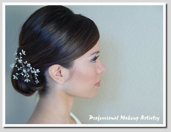 chignon...what do you think about this? Maybe minus the baby's breath...but its chic!   # Pin++ for Pinterest #