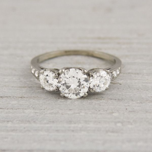 I love this, its so me. The style is perfect. Though White gold with cushion cut diamonds - Vintage Tiffany & Co. Three Stone Engagement Ring.