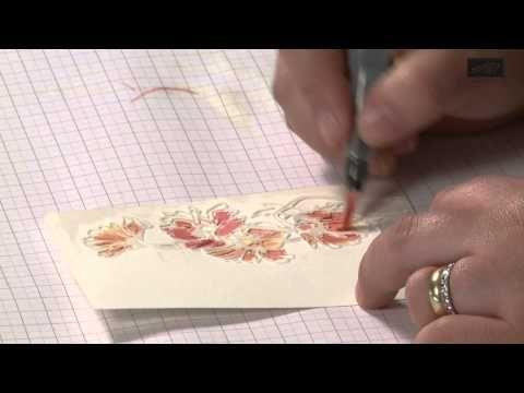 In dieser Folge stellt Charlotte die Doppelpräge-Technik vor mit der sich Karten, Boxen oder Scrapbook-Seiten ganz besonders schön verzieren lassen. Die erste Prägung geschieht mit der Big Shot, die zweite mit der VersaMark-Tinte. Durch die unterschiedlichen Prägungen entsteht eine schöne 3D-Optik, die gleichzeitig in bunten Aquarell-Farben leuchtet.