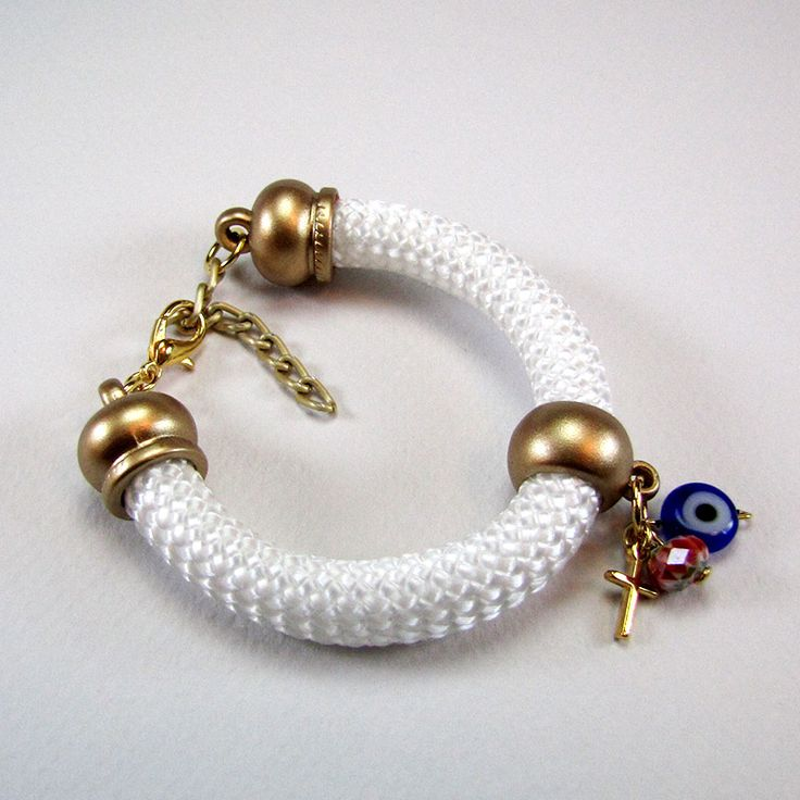 Bracelet with white climbing cord and golden matte endings, golden cross, blue glass evil eye and red murano bead.