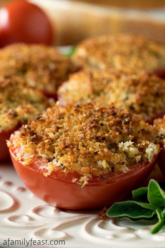 Baked Stuffed Parmesan Tomatoes - A incredible stuffing made from crispy bread crumbs, cheese and garlic is packed into sliced tomato halves, then baked.  Super simple and super delicious!