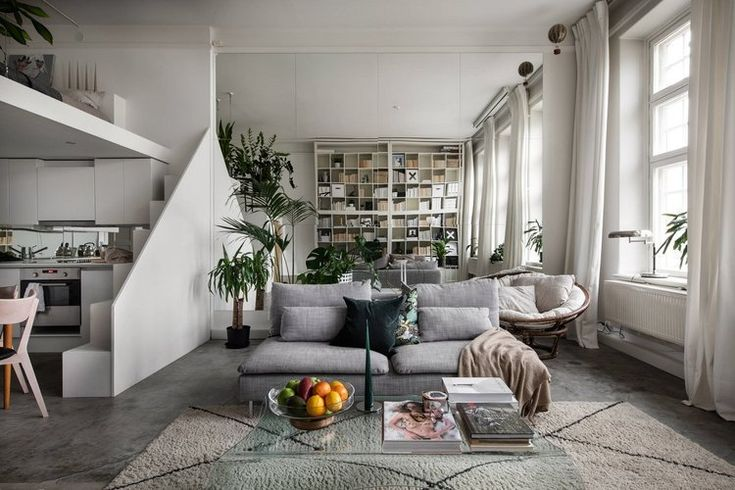 A Small Scandinavian Loft Looks Spacious Thanks To A Mirrored Wall