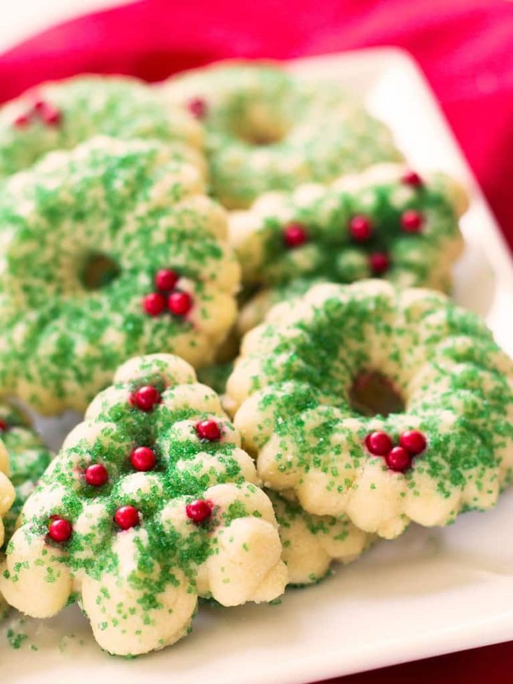 Holiday butter spritz cookies melt away in your mouth and are perfect for cookie swaps. | www.ifyougiveablondeakitchen.com