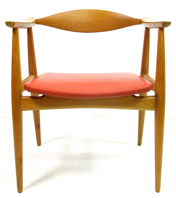"""A 1960s """"CH-35"""" armchair in oak and red leather by Hans Wegner for Carl Hansen.   With organically sculpted backrest, tapered legs and floating seat, the arms emerge from the back to create a wonderful modernist form.   The oak is beautifully grained, the leather unblemished.   Like the best sculpture this chair is visually striking from all angles.   All joints are absolutely sound, the wood and leather in perfect condition. The Carl Hansen manufacturer mark is stamped on the underside."""