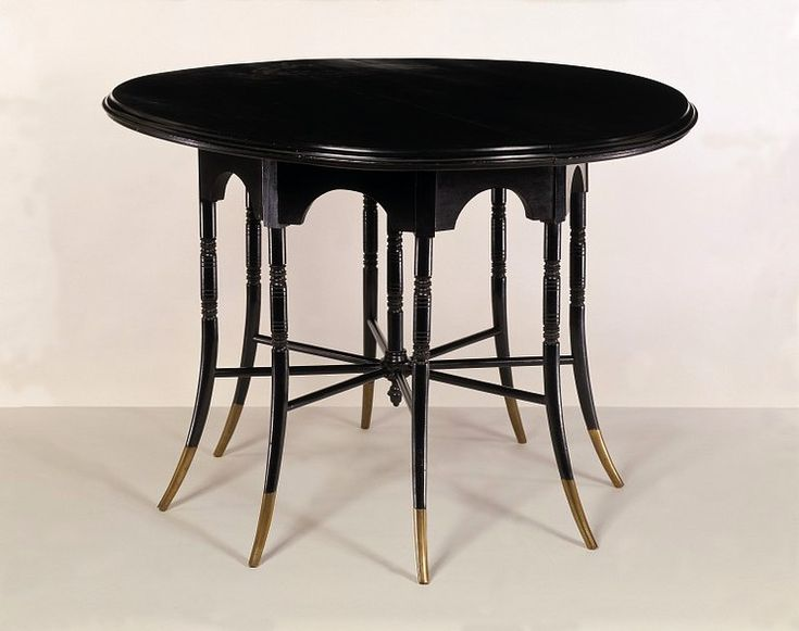 Edward William Godwin, table - 1876. Ebonised wood, probably mahogany, with brass feet.