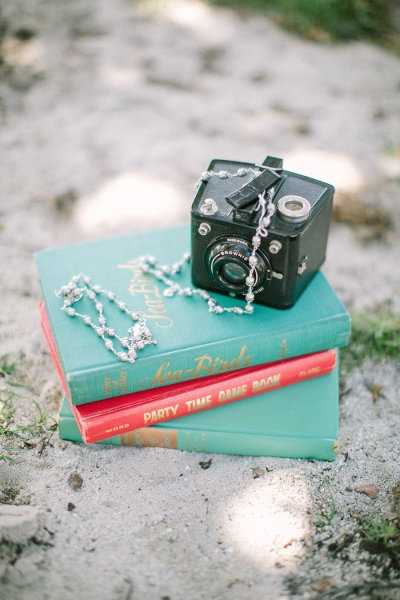 A lovely stack of vintage books serving as a backdrop for the bride's necklace
