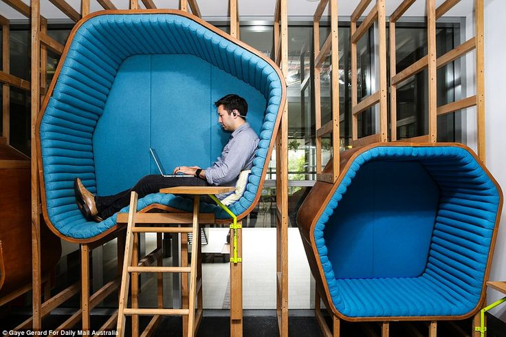 Different shaped and sized pods are hung on the walls for staff members to have some privacy and comfort as they work