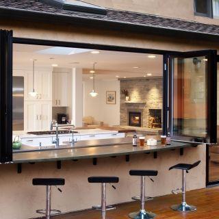 Kitchen window behind sink onto back porch