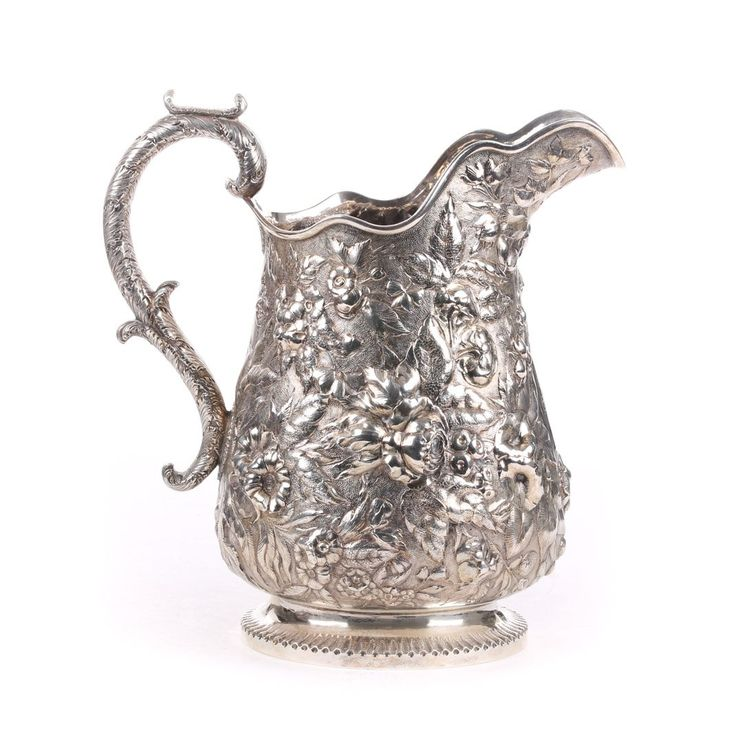 S. Kirk & Son repousse coin silver water pitcher.