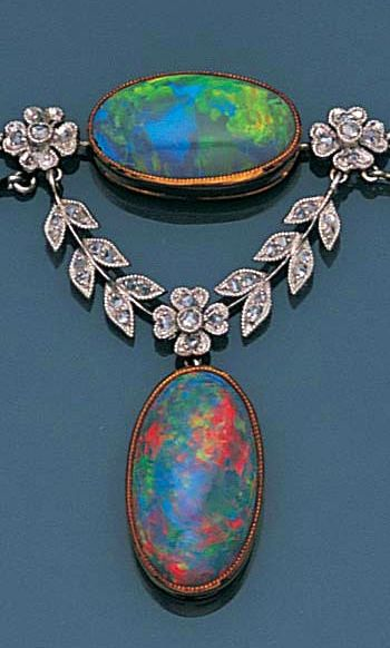 A belle époque opal and diamond necklace, circa 1900 Designed as a garland of millegrain-set rose-cut diamonds, with an oval cabochon opal to the centre, each knifewire wreath graduated in size and suspending a cabochon opal drop, on a fine trace-link chain, length 41.0cm.