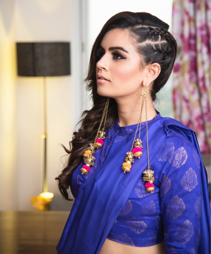 Hairstyles- Side Plaited Braid with Open Hair on the Side with Long Hanging Gotta Earrings | WedMeGood #wedmegood #indianbride #indianwedding #bridaljewlery #gottajewlery #hangingearrings #sideplaits