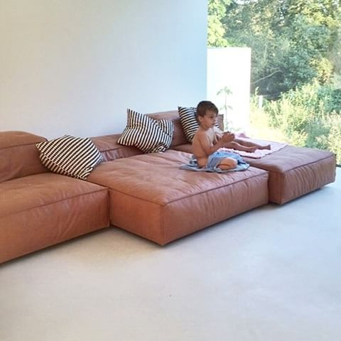 """""""Life is so much easier when you just chill out.""""LIVING DIVANI Extra soft sofa designed by Piero Lissoni ."""