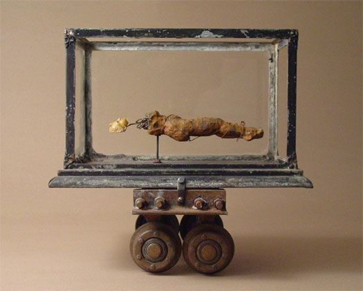 Breach of Contract-  James Michael Starr 2006 Assemblage - terrarium, ceramic figure study, plaster head, industrial carriage, wire 17 1/2 x 18 1/2 x 13 1/2""