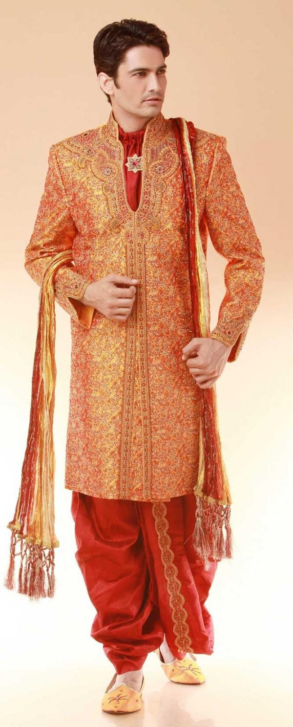 This orage sherwani may be too colorful for my groom's taste, but it sure is stylish.