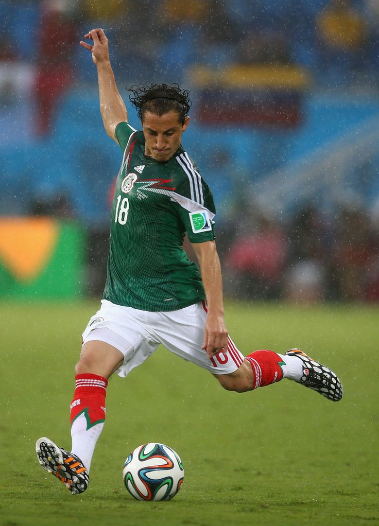 Andres Guardado of Mexico kicks the ball during the 2014 FIFA World Cup Brazil Group A match between Mexico and Cameroon at Estadio das Dunas on June 13, 2014 in Natal, Brazil.