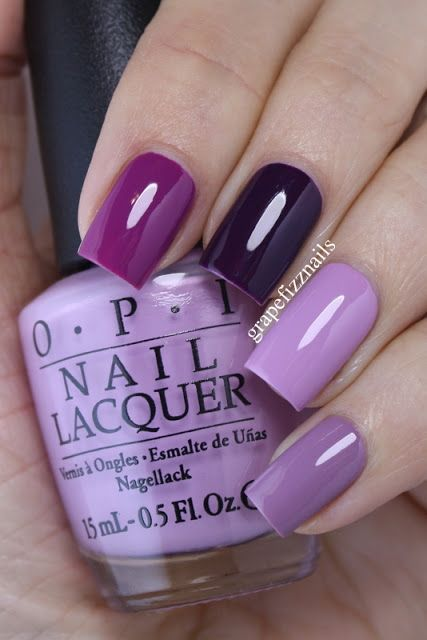 Hey Dolls! I have a purple skittle mani to show you today!  I always love a good skittle mani, and I find I get a lot of compliments/comments when I wear one!  On my index finger I am wearing Essie Fl