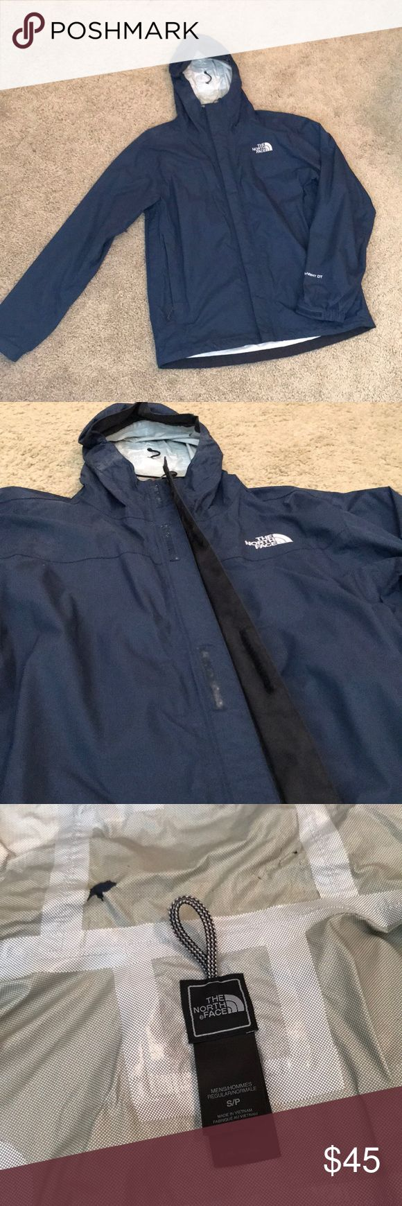 North Face Rain Jacket Men's North Face Rain Jacket.  Navy Blue.  Size Small.  Great Condition!  *I wore this and it fit me like a Women's Medium* *See photos for small rip in the liner on the hood* *See photos for small rip on the double liner in pocket*  Reasonable offers are acceptable!! North Face Jackets & Coats Raincoats
