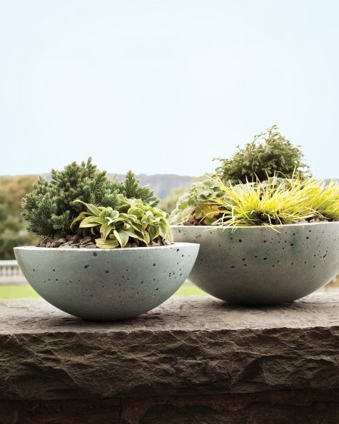 Hypertufa was developed in the 1930s to replicate the stone troughs that were popular among English gardeners in the late 19th and early 20th centuries. The lightweight stand-ins were not only easier to come by, but also easier to transport. Thanks to their porous nature, the pots were ideal for plants needing good drainage. Hypertufa containers are still practical in the garden and simple to create.