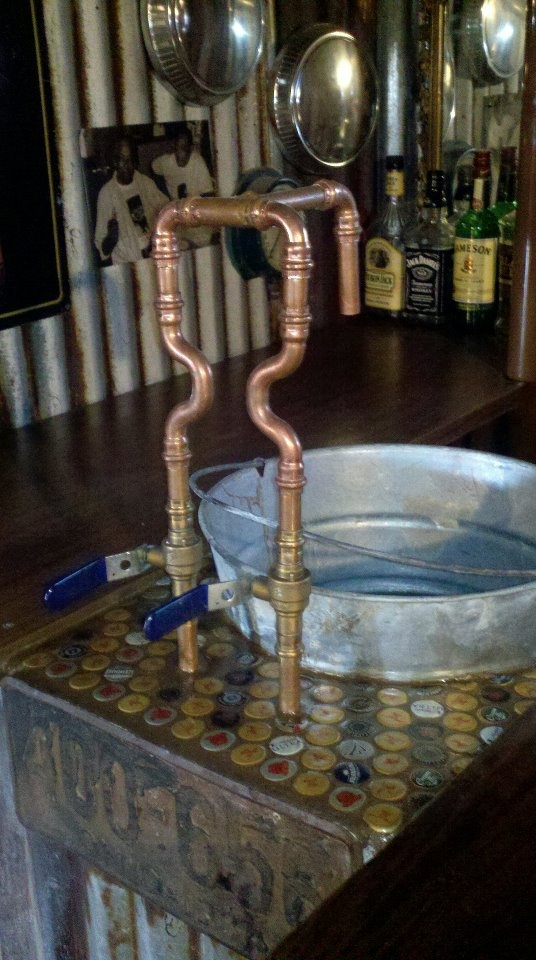 Rustic bar sink, don't forget the bottle cap counter top!
