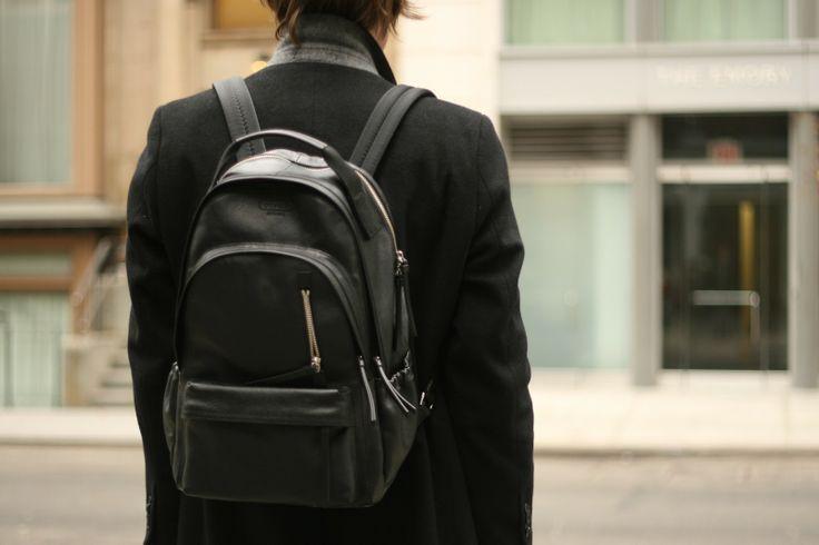 @Coach, Inc. black leather backpack