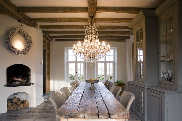 Exposed wood beams reflected in the table. Country. Chandelier.