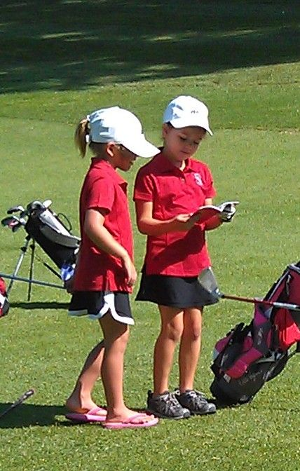 Learning the rules of golf  :), you carry a rule book in your bag, right ?
